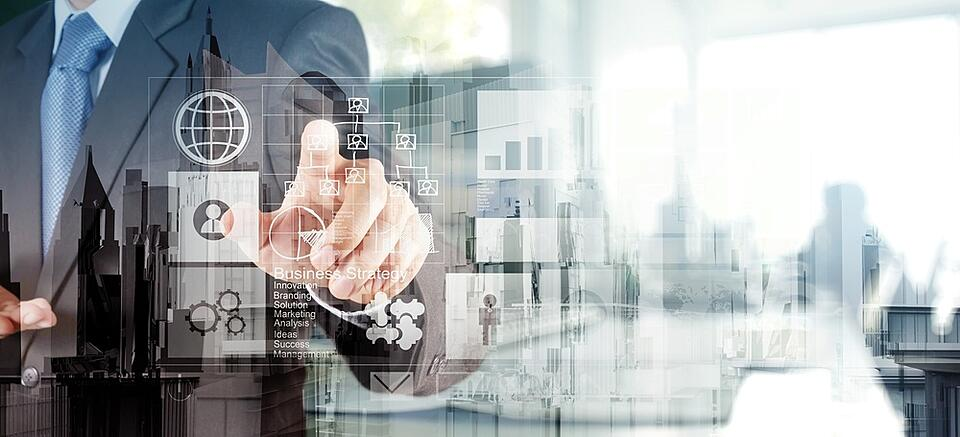 Double exposure of  businessman hand working with new modern computer and business strategy as concept.jpeg